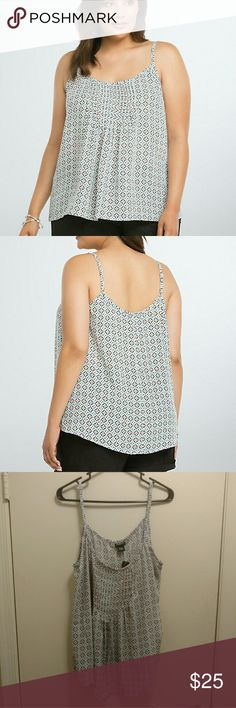Torrid - Tile print pleated cami Never been worn. Light, airy cami in a tile print with pleating in the front. From Torrid - size 0  When prepping your packing list for your next vacay, pencil this cami top in first. The multi-color tile print already looks like you spent a year abroad shopping. The pleated neck lends swing to the throw-it-on-and-go pleated bodice. torrid Tops Camisoles
