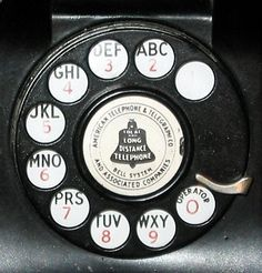 Dial of vintage telephone with alphabet numbers. Phone numbers in had a letter, then 4 numbers dialled afterwards (I think it was either 3 or 4 numbers). In late phone numbers went to 7 numbers, and in to 10 numbers. Vintage Phones, Vintage Telephone, Lps, Dial M For Murder, Antique Phone, Phone Companies, Old Phone, Alphabet And Numbers, The Good Old Days