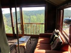 Gorge View self-catering tree house at Teniqua Treetops is located in a forest overlooking the Karatara River gorge and the Outeniqua Mountains between Sedgefield and Knysna on the Garden Route of South Africa www.teniquatreetops.co.za