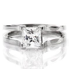 The Cathedral design has four chevron prongs that frame a 1.00 carat princess cut diamond solitaire. http://www.knoxjewelers.biz/products/cathedral