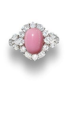 A conch pearl and diamond ring