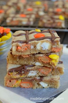 Peanut Butter Nutella Cookie Bars - peanut butter cookie bars with a swirl of Nutella and Reese's pieces