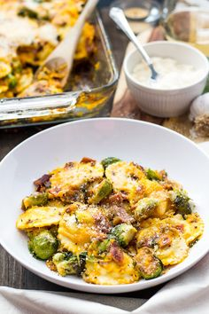 Filled with brussels sprouts, shallots & bacon, this Butternut Squash Ravioli Bake is an indulgent fall recipe perfect for cozy nights on the couch.