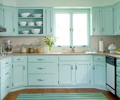 Love these light turquoise cabinets...so cheery, they make me want to cook!
