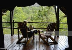 View top-quality stock photos of Woman In A Chair Reading A Book Clarens Free State Province South Africa. Find premium, high-resolution stock photography at Getty Images. Free State, Photos Of Women, Royalty Free Images, South Africa, Patio, Stock Photos, Outdoor Decor, Travel, Home Decor