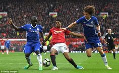 N'Golo Kante (left) and David Luiz in action with Marcus Rashford at Old Trafford on Sunday