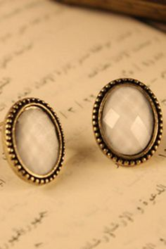 Retro oval earrings, featuring the jeweled design with rhinestone and a bullet clutch fastening to reverse.