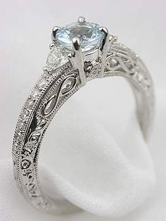 Aquamarine Filigree Engagement Ring (Also a bit too ornate, but I like the infinity knot symbol)