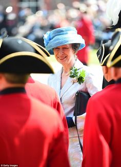The Princess Royal was barely visible among the distinctive red coats and tricorne hats at today's event