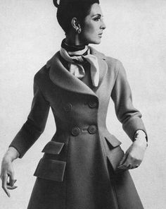 1965 Model Mirelli Pettini is wearing a tangerine wool coat by Bonwit Teller and photographed by William Klein.