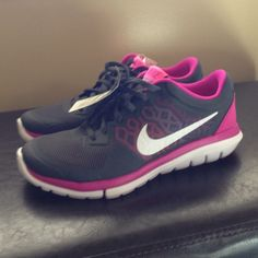 Nike Flex shoes- brand new! Nike Flex. Brand new! Dark gray and a magenta sort of color on the outside. Mixed pink colors behind Nike symbol. Nike Shoes Athletic Shoes
