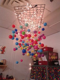 The balloons hanging from the rack.