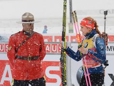 Passing a Royal Canadian Mounted Police member, Gabriela Soukalova of the Czech Republic heads to the podium after finishing third in the Mass Start Women's 12.5 km event at the World Cup Biathlon in Canmore, Alberta