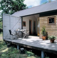Awesome! open that huge door and your outside! Danish summer house prefab modular Lykke Nielsen ; Gardenista