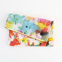 "This handmade in California clutch is covered in painterly blobs, digitally printed on thick cotton twill. Fully lined with printed cotton and zipper, it's the perfect size for carrying all of your on-the-go essentials like your phone and digital camera, or use it to store jewelry, cosmetics pens and more.   Material: Cotton twill Size: 11"" x 11.5"""