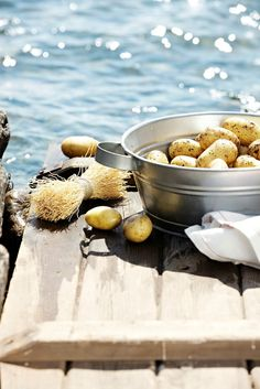 Special privilege of cottage living; washing fresh potatoes in the lake! Clean drinking water always at hand. SM | Summer in Finland
