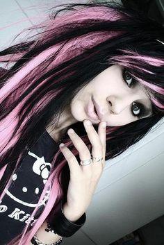 Cotton candy pink in ebony hair chunk, teased modern day rock hair, peak a boo shaped bang. Model: Gabriella Drömer