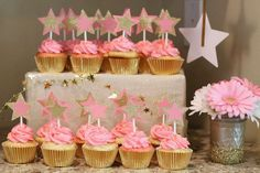 Star topped pink and gold cupcakes at a Twinkle Twinkle Little Star birthday party! See more party ideas at CatchMyParty.com!