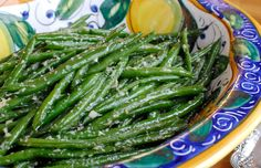 Here is a recipe for fresh string beans, boiled just until barely tender and bright green, then tossed in a pan with minced garlic and ginger The beans can be cooked a day ahead, leaving nothing more to do before the meal than to assemble everything over high heat.
