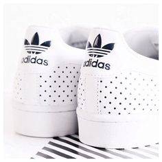 White perforated Adidas Stan Smith