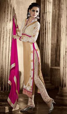 Beige and Cream Embroidered Georgette Party Wear Suit Feel beautiful in this beige and cream embroidered georgette party wear suit. This wonderful attire is displaying some great embroidery done with jaal, patch, resham and stones work.  #GeorgettePartyWearSuit #BridalChuridarSuits