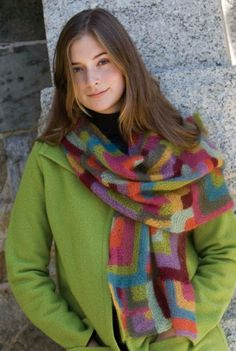 The colorful Modern Quilt Wrap by Mags Kandis is a wonderful knitted accessory for everyone to enjoy