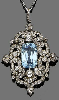An aquamarine and diamond pendant necklace, circa 1890 The old brilliant and single-cut diamond cartouche, centrally set with an oval mixed-cut aquamarine, to a rose-cut diamond suspensory loop and a trace-link chain, diamonds approx. 3.00ct total, originally a brooch/pendant, brooch fitting deficient, lengths: pendant 5.2cm, chain 42.4cm