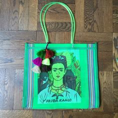 """Frida Tote! Both sides have a unique Frida Kahlo portrait. The perfect summer tote. Beach, office, farmers market.... Look stylish no matter what. Silk screened and direct from a woman owned artesian market in Mexico City. 15"""" L X 17"""" W X 5"""" D. Handle drop is 10.5"""". Tassel sold separately. Costume Baldor Bags Shoulder Bags"""