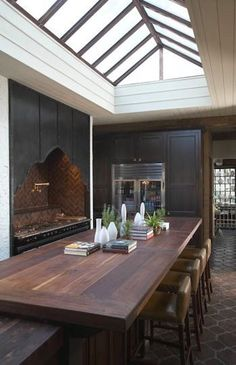 A copper and glass skylight defines this dramatic kitchen, designed as an addition to a 1920's Spanish Revival residence in Homewood, Alabama.