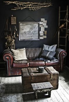 I know this looks a lot like a man's room, but I want it. The dark colors, leather couch, and hints of blue. It's amazing.