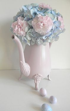 Hydragea and pink carnation flower posy in teapot