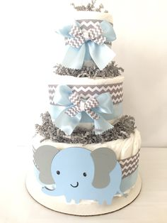 Elephant Diaper Cake (diaper cake-baby shower diaper cakes - unique boy diaper cakes - baby diaper cakes- diaper cakes for boys by AllDiaperCakes on Etsy https://www.etsy.com/listing/177423292/elephant-diaper-cake-diaper-cake-baby