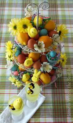 I like this display..I like the colored eggs and fresh flowers,,going to look for a shabby chic 3 tier
