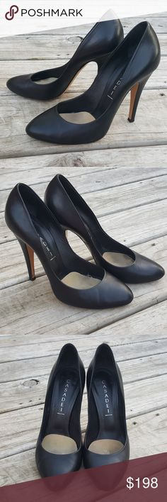 Casadei Black Leather High Heel Pumps 9.5 These sexy, classic pumps feature a soft black leather. They are in very good pre-owned condition with only minimal wear, primarily around the heels as can be seen in the 7th photo. Size 9.5. *Casadei runs small, so if you have not worn this high end designer brand before please see their sizing info. Casadei Shoes Heels