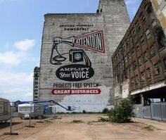 """New Shepard Fairey piece up in London """"Attention"""" is his biggest yet. Just in time for the Olympics."""