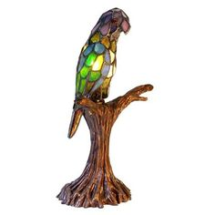 Warehouse of Tiffany 3268+BB925 Style Parrot Accent Table Lamp This product from Warehouse of Tiffany is illuminated by one 25-watt frosted incandescent