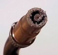 Shows you what the MIG torch nozzle tip looks like with weld spatter build up.
