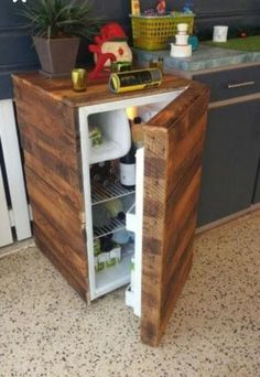 To add some creative impressive features in your kitchen you are best left with the idea of pallet mini fridge. This fridge will be designed as small in size and would be completely covered with the old wooden pallet material. You can beautifully design it by adding some more creative ideas coming all the way in your mind.
