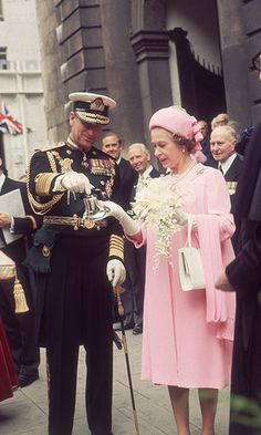 Queen Elizabeth II and Prince Philip admire a silver bell on the occasion of her Silver Jubilee in 1977.