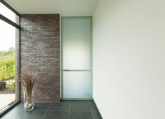 Modern glass doors made-to-measure with draft and acoustic insulation without floor fixtures. Acoustic Barrier, Black And White Interior, Black White, The Doors, Modern Glass, Contemporary Interior, Glass Door, Clear Glass, Minimalism