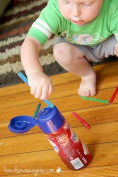 A fine motor activity to keep toddler busy using a plastic bottle