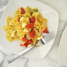 Classic Italian pasta salad, made with fresh tomatoes, mozzarella and a light basil pesto. Cooking with Manuela