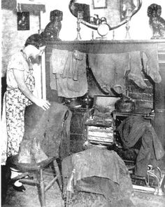 Black and white photograph of 1940s housewife ironing