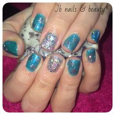 Blue & silver wintery gel polish on natural nails with snowflakes