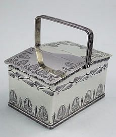 Antique Tiffany sterling silver double tea caddy in the shape of a picnic basket. Applied Greek Key borders and engraved bands of decoration including a band of tea leaves with a beautiful Victorian monogram in the center, circa Tea Canisters, Tea Tins, Tea Strainer, Tea Infuser, William Morris, Cafetiere, Tea Caddy, Chocolate Pots, Tea Accessories