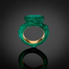 Emerald, with gold sleeve. Image courtesy: Al Thani Collection