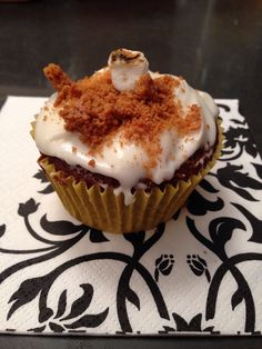 S'mores Cupcake  -chocolate cupcake -marshmallow cream filling -Grahm cracker crumble topping -roasted marshmallow topping  -my own invention