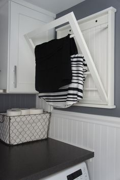 Wall mounted, fold-away drying rack. Handy piece when there's not much floor space available!