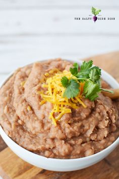 Slow Cooker Refried Beans are a flavor-filled Mexican Side Dish that you never knew was SO easy to make Refried Beans Slow Cooker, Homemade Refried Beans, Beans In Crockpot, Mexican Side Dishes, Side Dishes Easy, Main Dishes, Slow Cooker Recipes, Crockpot Recipes, Cooking Recipes