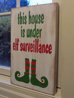 This house is under elf surveillance sign